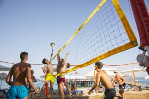 people playing volleyball on beach 300x200 - People playing Volleyball on beach