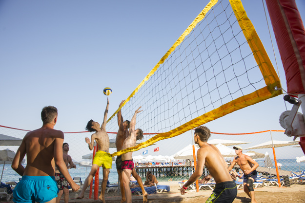 People playing Volleyball on beach