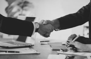 people 3303828 960 720 300x196 - bacl and white shake hands